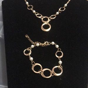 Necklace and bracelets with earrings
